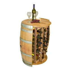 Napa East Wine Barrel 28 Bottle Round Wine Rack - Keep your cherished varietals safe and secure inside the cleverly designed Napa East Wine Barrel 28 Bottle Round Wine Rack. Made with two wine barrel sides and a wine barrel top and bottom, this spacious rack holds up to 28 bottles. In addition, the middle row in the rack is two bottles deep and can accommodate larger bottles.About Napa EastNapa East creates wine-inspired furnishings that are made from actual reclaimed oak wine barrels. Their barrels began life handcrafted with pride from the finest French and American Oaks, and Napa East continues that theme when they hand-select barrels and giving them new life as beautiful one-of-a-kind works of art.