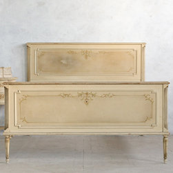 """Eloquence - Eloquence One of a Kind Vintage Full Bed Louis XVI Warm Beige - The Eloquence One of a Kind collection offers the warmth and character of authentic vintage finds. A treasure trove of unique antiques, the classic French and European pieces boast an original patina that's been aged and distressed from years of love and everyday use. A stunning accent for master and guest bedrooms, this vintage Louis XVI-style bed creates a timeless and distinct statement. Designed with hand-carved wood, clean lines and fluted legs, the furnishing features a warm beige finish. Beautiful hand-painted flowers adorn the headboard and footboard for a romantic finishing touch. Available in full size only. Circa 1950. 59""""W x 82""""D x 47""""H. Footboard: 30""""H."""