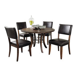 """Hillsdale Furniture - Hillsdale Cameron 5-Piece Round Wood Base Dining Set with Parsons Chair - Hillsdale's Cameron collection beautifully combines a warm chestnut brown wood finish with a dark grey metal and offers a multitude of choices to create the perfect dining group for your home. Starting with the chairs, you have the choice of three lovely designs: The X-Back chair combines a warm chestnut brown top accent with a transitional metal X in the center of the back and a brown faux leather seat. The parson's chair is traditional in design and combines the warm chestnut brown finish with the brown faux leather seat. The ladder back chair features 3 rungs in the chestnut brown finish, enhanced by the dark grey metal and brown faux leather seat. Now that you have decided on your chair, let's look at the table options: The stunning rectangle table features a wood top that is generously scaled to easily accommodate 6. The simple round table features a 48"""" diameter wood top with flared metal legs. The round wood table is 48"""" in diameter and features a wonderful metal accent on the base."""