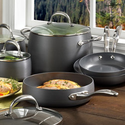 Earth Pan - Earth Pan II Hard-Anodized 10 Piece Cookware Set - 80963 - Shop for Cookware Sets from Hayneedle.com! You can whip up a scrumptious breakfast in no time or serve up a perfectly prepared five course meal with the Earth Pan II Hard-Anodized 10 Piece Cookware Set. The Earth Pan Cookware Set includes all the essentials each crafted of ultra-tough hard-anodized aluminum: two saucepans two skillets a medium saute pan and a large stockpot for soups or stews. The Earth Pan Cookware Set features innovative nonstick surfaces that set this set apart from all other pots and pans. Using SandFlow technology these pieces are eco-friendly and chemical-free so they won't release harmful PTFEs or PFOAs like other nonstick cookware might. Designed for superior cooking these pots and pans feature aluminum exteriors that heat quickly and provide consistent even heat distribution. With dual-riveted ergonomic handles in stainless steel each skillet features a protective silicone handle in sleek silver that stays cool to the touch. The Earth Pan Cookware Set is oven safe to 550 degrees and hand washing is recommended for best results. About Meyer CorporationMeyer Corporation U.S. based in Vallejo Calif. has been one of the fastest-growing cookware companies in the United States and is now the largest distributor of range-top cookware in the country. Meyer Corporation specializes in the distribution of metal cookware and other kitchen products. The cookware is made by Meyer Corporation's own affiliate factories throughout the world; offering different brands enables the company to distribute different levels of cookware. Meyer Corporation's focus is on developing high-quality top-performing cookware using cutting-edge technology and designs. The company offers cookware made from stainless steel hard-anodized aluminum and non-stick aluminum.