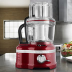 Frontgate - KitchenAid Pro Line Series Food Processor - Features an external lever that allows you to go from thick to thin settings with ease. Exclusive 3-in-1 Ultra Wide Mouth™ Feed Tube provides horizontal and vertical slicing while accommodating foods of all shapes and sizes (including large vegetables like potatoes and cucumbers). 16-cup UltraTight Seal bowl with leak resistant ring helps you handle large recipes like a pro. Includes 16-cup bowl, 10-cup bowl, 4-cup bowl, dicing kit, cleaning tool, adjustable slicing disc, reversible shredding disc, multi-purpose blade, dough blade, spatula, and storage case. 5-year limited warranty. The KitchenAid Pro Line Series 16-Cup Food Processor is the first residential food processor with hands-free, commercial-style dicing that's calibrated for your countertop. It debuts an advanced dicing mechanism that, along with the ExactSlice System, ensures you'll achieve professional style results in your very own kitchen.. . . . .
