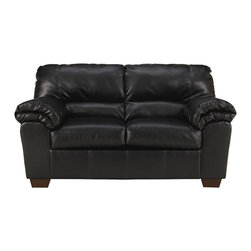 Signature by Ashley - Commando Loveseat in Black Leather - Contemporary Design. Plush Pillow Top Upholstered Arms. Black Faux Upholstery. Bustle Back Cushions. Fixed Back. Loose Seat Cushions. CA117 Fire Retardant Foam. Black Bottom Dust Cover. Plastic Triblock Feet. Durable Frame Construction. Seat and Back Spring Rails cut from .875 in. Thick Hardwood. Corners are Glued, Blocked and Stapled. Upholstery pre-approved for wearability and durability against AHFA Standards. Cushion core constructed of low melt fiber wrapped over high quality foam. 100% Polyurethane. Spot clean with water based cleaner.