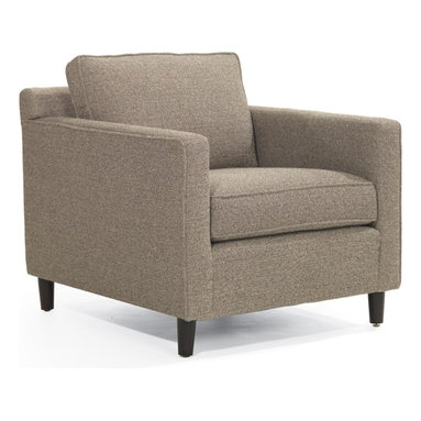 Martin Chair - Long, low, and streamlined, with clean minimalism, the Martin chair is a tribute to Mid-century modern design. Tall, round recessed legs enhance the modern feel. Martin's loose seat and back cushions offer exceptional comfort while keeping the look sleek.