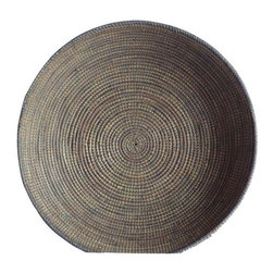Pre-owned Hand Woven African Basket - A nice large scale handmade basket of reed grass woven with light gray plastic cording. This piece is perfect for a coffee table, dinner table for catch-all for magazines or fruit.