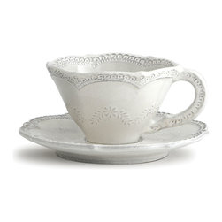 Merletto Antique Scalloped Cup and Saucer - Give every guest and family member the royal treatment with the flawless white-on-white elegance of the Merletto Antique Scalloped Cup and Saucer. Formed in a traditional teacup shape from Italian ceramic, then hand-impressed with dainty lace designs and glazed in snow white, this cup offers breathtaking beauty and distinctively classic styling on the table.
