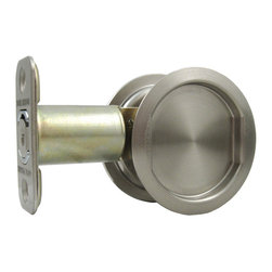"""Stone Harbor Hardware - Round Pocket Door Lock (passage) , Satin Nickel, 2-3/4"""" Backset - The round passage pocket door lock is available in satin nickel and vintage bronze. The latch face opens with the push of a finger and acts as a pull to open the door. Fits 1-3/8"""" to 1-3/4"""" thick doors and is available with either a 2-3/8"""" backset or a 2-3/4"""" backset. The lock fits a standard 2-1/8"""" door prep for easy installation."""