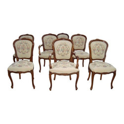 "Used Italian Dining Chairs and Accent Chair - Set of - These vintage Italian chairs, made around 1950, have original cream needlepoint upholstery. They are decorated with beautiful carvings and are extremely sturdy. The chair structure is in excellent condition. However, the upholstery has some spots and could use a cleaning. Included are 2 arm chairs, 4 side chairs and 1 accent arm chair.     Dimensions:  Arm chairs: 22"" W x 21"" D x 38"" H, Seat height 20""  Side chairs: 20"" W x 19"" D x 38"" H, Seat height 20""  Accent chair: 22"" W x 21"" D x 34"" H, Seat height 16"""