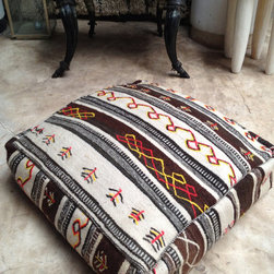 Moroccan Kilim Pouf Cover by Bazaar Living - Every living room could use another pouf that doubles as an ottoman or extra seat. This handmade pouf cover uses vintage kilim rugs in a more traditional white on brown color palette. You provide the insert.