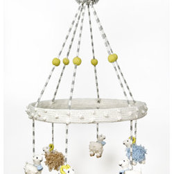 Sheep Mobile - This knitted mobile redefines counting sheep. Dangling in a simple circle, these sheep will keep your baby content for minutes on end in their crib. Yessss.
