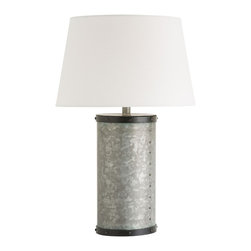 Arteriors - Leo Lamp - This galvanized cylinder lamp body is trimmed top and bottom with natural iron and has hand applied rivets running vertically down the side. This is a rustic look but keeps it's modern feel with a simple lined off-white linen shade with rolled edges. Takes one 150 watt three-way bulb.