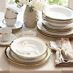 "Caroline Porcelain Dinnerware, 20-Piece Cereal Bowl Set, Gold - Make a celebration even more memorable with a thoughtful gift. Handcrafted with gently uneven rims, our new Caroline Registry dinnerware has understated glamour that's just right for both formal and casual settings. We've wrapped it in a beautiful gift box so it's ready for giving on any special occasion. Dinner Plate: 11"" diameter, 1"" high Salad Plate: 8.5"" diameter, 1"" high Bowl: 9"" diameter, 2"" high; 5.5 fluid ounces Cup: 4.5"" wide x 3.5"" deep x 3"" high Saucer: 6"" diameter Made of porcelain with a glazed finish. Gold trim. Set of 4, choose dinner plate, salad plate, or cup-and-saucer set. Packaged in a beautiful PB storage box. Dishwasher-safe. Gold is Catalog / Internet only. Read more on our blog about the inspiration behind this product."