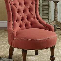 Mia Chair - Merging a hint of Victoriana with mid-century aesthetics, the well-proportioned Mia Chair is distinguished by its hand-tufted back, rounded seat and gracefully sloping arms. Beautifully appointed with antiqued brass nailhead trim and contrast whipsitch accents, the petite footprint makes this an excellent choice for a bedroom or small sitting room. And the bright linen upholstery is sure to add a pop of welcome color wherever it's placed. Solid birch frame with antique walnut finish. Paprika, natural or eggplant.