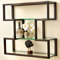One Up Wall Shelf - The geometric frame of the One Up Wall Shelf is finished in an attractive, aristocratic caf� brown, but the effect of the shelf is wonderfully light, simply offering a surface and a frame for setting objects against your wall color � a superb way to govern your decorative palette and emphasize the look of favorite treasures.  Three glass shelves allow ample illumination.