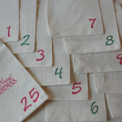 Vintage Christmas Advent Calendar Organic Cotton Bags by Jennifer's Cookies - You can make your own advent with these vintage-looking bags. Hang them up or hide one on your child's pillow each day filled with a small gift for a fun surprise.