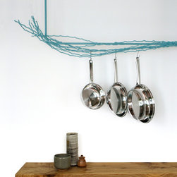 Merkled Pot Rack - The Merkled Pot Rack is made from salvaged steel loom ends collected from a weaving company 10 blocks from the Merkled studio. Each piece is unique in its organic form and is powder-coated for durability. The Merkled Pot Rack can hold the lightest whisk to the heaviest cast iron skillet. It comes in L shape for corner installations, U shape for over an island and wall-mounted version.