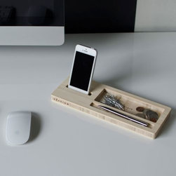 iSkelter - Classic Station by iSkelter - The iSkelter Classic Station is a sleek, sophisticated and sustainable solution to too much desktop clutter. It's not a charging station, but allows you to keep your smartphone within easy reach and organize your keys, pens, sunglasses, etc. It is a simple and naturally beautiful desktop caddy made entirely out of rapidly renewable bamboo. iSkelter makes docks and storage caddies that are more than worthy of charging and displaying the lovely technological wonders that are iPads, iPhones and other smartphones. These accessories feature simple yet elegant, modern designs made out of natural, 100% sustainable bamboo. All iSkelter products are designed and handcrafted at their workshop in Tempe, Arizona.