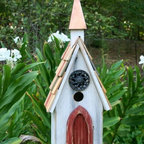Heartwood - Jubilee Bird House - A  famous  architect  once  said,  God  is  in  the  details.  And  as  you  can  see,  the  architectural  details  in  this  pastoral  gem  are  nothing  short  of  heavenly.  Filigreed  cast  iron  medallion  makes  for  an  elegant  counterpoint  to  the  A-line  roof  and  copper  steeple,  while  the  weathered  painted  door  offers  an  abiding  beauty.  Expect  much  rejoicing.                  8x9x24              1-1/2  hole              Handcrafted  in  USA  from  renewable,  FSC  certified  wood