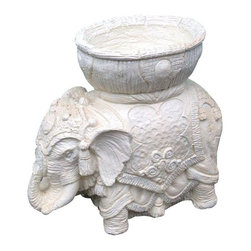 Used Large Vintage Elephant Planter - Beautiful vintage elephant planter with ornate details. The elephant trunk is up meaning good luck. This is a large statement sized piece. Perfect for indoors or out. The material is unknown, but the piece is heavy. Possibly plaster.