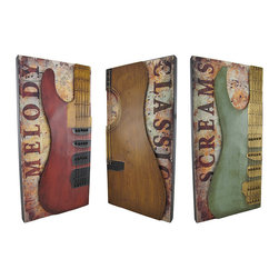 Set of 3 Guitar Wall Hangings - This set of vertical wall hangings showcases rockin` guitars mounted on wooden box frames with sheet music backgrounds. Each measures 23 3/4 inches tall, 11 3/4 inches wide, 1 3/4 inches deep, and easily mounts to the wall with 2 nails or screws by the metal hangers on the back. This set is a wonderful accent to the home of any music lover, and it looks great in restaurants or bars, as well.