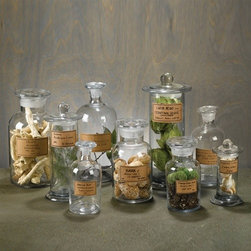 Set of 9 Apothecary Jars - This eclectic set of vintage-looking apothecary jars will add personality to your bathroom while giving everything a more uniform look. Ditch the packaging from your cotton balls, cotton swabs and bath salts and load these up.