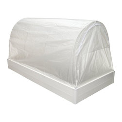 Guarden - Guarden GK Series Deep 4 x 8-Foot Mini Greenhouse - GK4896D - Shop for Greenhouses from Hayneedle.com! Additional FeaturesChange covers dependent on the seasonsCover doubles as a season extenderCover features a dual-purpose hinge/latchCover can be opened from either sideHas the features of a raised-bed greenhouseUnlimited root depth compactness and drainageLift out hoops convert the greenhouse to a raised bedConversion doesn't require toolsHeavy duty plastic frameFrame has 3 internal insulating air cellsAir cells keep the soil's heat from escapingFrame will not fade crack rot or splitBeautiful rounded cornersPre-drilled holes and push-in fasteners make assembly easyTitanium Dioxide protects against UV raysLightweight and solidly constructedRaised bed planter arch supports and greenhouse coverYou can add heating irrigation or other accessoriesCan be used in your yard patio deck or platformThe Guarden GK Series Deep 4 x 8-foot Mini Greenhouse provides all the benefits of a traditional greenhouse without taking up the space. Constructed to have the solar heat of a cold frame the plant headroom of a greenhouse and the unlimited root depth compactness drainage manageability and convenience of a raised bed this greenhouse is perfect for anyone who is lacking space or wants to try gardening without making a large investment. This mini greenhouse will fit on a patio deck or platform and only requires a landscape liner. With a cover that doubles as a season extender you also have the versatility of switching covers depending on the time of year.The heavy duty plastic frame has three internal insulating air cells which keeps the heat from escaping the soil. It also features Titanium Dioxide to protect against UV rays. The frame will not fade or crack and acts as a natural barrier against weeds. With an extra 5-inches of depth this mini greenhouse will raise your plants to a higher level and showcase them. Lightweight and solidly constructed you can add heating irrigation and other accessories as needed or desired. The lift out hoops lets you convert your mini greenhouse to a raised bed garden or planter without tools and the pre-drilled holes and push-in fasteners make assembly easy. Made to fit in small spaces this mini greenhouse measures 48W x 96L x 53.5H inches.