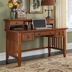 HomeStyles - Executive Desk with Hutch (Cottage Oak) - Finish: Cottage OakLattice moldings. Slightly flared legs. Drop-front center drawer can be used as a keyboard tray. Two additional storage drawers on each side. Clear top coat help to protect against wear and tear from normal use. Hutch provides cable access and additional storage with two storage drawers and a center storage shelf. Black finish hardware. Made from Asian hardwood and veneer. 54 in. W x 28 in. D x 39.5 in. H. Desk Assembly Instructions. Hutch Assembly InstructionsMission styling at its best! The arts and crafts executive desk embellishes typical mission styling with framed doors showcasing raised wood.