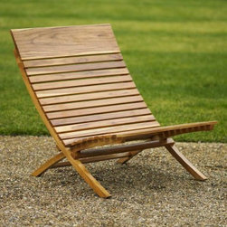 Valencia Teak Chair - This teak chair has a classic feel. Inspired by the Barcelona chair introduced by Mies van der Rohe at the 1929 World Exposition in Spain, it has classic lines and is perfect for comfortable sitting. It's effortlessly stylish.