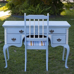 Painted and distressed furniture - This antique mahogany desk has a new personality after being painted Louie Blue with a graphic stenciled writing top. We paired it with a bamboo styled chair painted to match for a coastal twist.