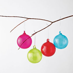 Colored Glass Sphere Ornaments - Holiday color schemes also need not be followed: dress up your home with ornaments in unconventional colors, like this magenta glass sphere from West Elm.
