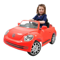 Aria Child Rollplay - Aria Child Rollplay VW Beetle Battery Powered Riding Toys Multicolor - W486TG-R - Shop for Tricycles and Riding Toys from Hayneedle.com! If Volkswagen captures the soundtrack of your life think of the Aria Child Rollplay VW Beetle Battery Powered Ride-On Vehicle as your child's overture. Complete with an MP3 connector so your kiddo can rock out to her or his favorite tunes this motorized kinderwagon will get your child moving in style. License-designed to look just the real thing your little one can feel just like Mom Dad or that extra cool aunt or uncle. More than just cool-looking however the level of detail on this ride-on toy is great for children's cognitive growth enabling them to really place themselves imaginatively in adult roles - an important part of understanding social constructions and interaction. And with a rechargeable 6V battery included your tot will be able to keep going for up to two hours at a time on one full charge. You'll love watching your kiddo zoom up and down sidewalks around the driveway and across playgrounds almost as much as they'll love doing it. And just like the real thing this VDub isn't built for off-roading. To keep your child safe and the vehicle operating properly keep it running on hard surfaces and off of streets grass dirt or gravel.Additional Features:MP3 connectorRealistic horn and engine soundsWorking LED headlightsRubber traction strips on tiresOpening doorRealistic mirrors windows and dashboardAbout Aria ChildThe folks at Aria Child believe that recognizing quality engineering starts a young age. That's why Aria Child goes to great lengths to equip each of its riding toys with unmatched detail full of innovative features. Licensing with premium car companies like Volkswagen and BMW allows Aria Child to produce lifelike luxury vehicles that let your little one really feel like Mom or Dad driving down the street. Working horns doors headlights and more all build a sense of realistic imaginative pla