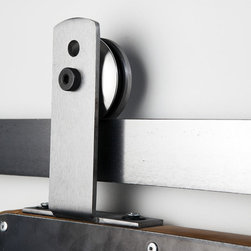 """Barn Door Hardware - Designed for mounting to the top of the door verses the face of the door, this top mounted Ultra Modern style allows for the functionality of rolling barn door hardware without the traditional face mounted installation. Characterized by its rounded top edge, and circle shaped detail the Ultra Modern Roller Hanger exposes the sides of the wheel as it rolls around the track. Due to its substantial look, our designers recommend using it in both modern and rustic applications. This hanger mounts to the top of the door. Perfect for doors that do not allow a face-mounted installation. E.g full glass panel with 2"""" wood frame."""