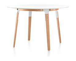 Magis - Magis Round Steelwood Table - This modern table turns the tables on, well, tables. Instead of a metal base and wood top, this one has a round top made of sleek white steel and the legs and apron accents are made of natural beech. It's a beautiful look for any breakfast nook or small dining area — or use it as a grand entry or lamp table.