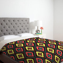 DENY Designs - DENY Designs Jacqueline Maldonado Zig Zag Ikat Duvet Cover Multicolor - 14069-DU - Shop for Duvets from Hayneedle.com! Vibrant colors and a fun zig zag pattern defines the DENY Designs Jacqueline Maldonado Zig Zag Ikat 1 Duvet Cover. Ultra-soft this entertaining duvet cover is made of 100 percent polyester microfiber that is machine washable. Neon colors of pink yellow and turquoise pop among the exquisite details of this custom printed design. Available in your choice of size each duvet cover features small metal snaps that ensure secure closure around your bed for a nice snug fit.About DENY DesignsDenver Colorado based DENY Designs is a modern home furnishings company that believes in doing things differently. DENY encourages customers to make a personal statement with personal images or by selecting from the extensive gallery. The coolest part is that each purchase gives the super talented artists part of the proceeds. That allows DENY to support art communities all over the world while also spreading the creative love! Each DENY piece is custom created as it's ordered instead of being held in a warehouse. A dye printing process is used to ensure colorfastness and durability that make these true heirloom pieces. From custom furniture pieces to textiles everything they make is unique and distinctively DENY.