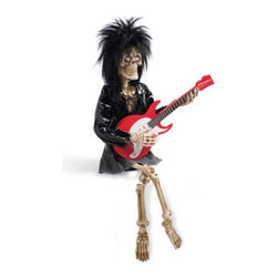 "Grandin Road - Bone Jet Animated Halloween Figure - She strums her guitar as her eyes flash and she sings, ""I love Rock and Roll!"". Decked out in full rocker garb, including a pleather jacket with zipper detail, denim mini skirt, hoop earrings, and a skull and crossbones necklace. There's no need to put another dime in the jukebox &ndsah; she's motion activated. You've gotta love that spiked rocker hair!. Requires 3 AA batteries (not included). Our animated, singing, Bone Jet skeleton figure strikes a perfectly harmonious chord between fun and frightful, making her a Halloween must-have. As she belts out her soulful tune, Bone strums away, costumed and bejeweled in her best rock ??n' roller outfit. She's destined to have ghosts and goblins of all ages entranced, and she's a delight to have hanging around your home all year round.  .  .  .  .  . Arrives fully assembled; instructions included . A Grandin Road exclusive."