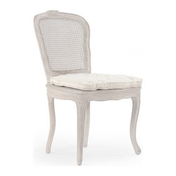 Kathy Kuo Home - Caned Back French Country Annette Dining Chair - Antique White - An intricately designed chair for the dining room, this piece, inspired by the French country style is carved from birch and features a caned back for a less formal look. The tufted seat cushion adds comfort and complements the elaborate carvings in the legs and seat frame.