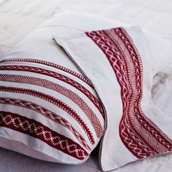 Linen Pillow Cover Sofia - Made by La Maison Bahira in Marrakech, these embroidered pillow covers are entirely stitched by hand. This coral red would be perfect on my bed — I may need to pick these up for myself!