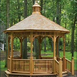 Victorian Gazebo - Our natural Victorian gazebo has a single tiered roof. Shown with optional hand railings and interior benches.