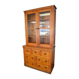 Pre-owned Late 19th Century American Pine Cupboard - Late 1800s American pine cabinet from Midwestern hardware store. Scalloped trim, wainscoting back, beveled glass door fronts with cast iron latch. Ideal for dining room storage and dish display. Glass-doored top unit is freestanding on base and could be used as a standalone piece. Drawer base with cast iron pulls could be used alone as dresser in bedroom or sitting room. Fits a traditional home setting or as a showpiece in a contemporary design.