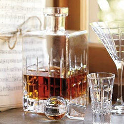 """Library Hand-Cut Glass Decanter - Handcrafted from rough-hewn glass, our decanter is a handsome collaboration of smooth edges and bold squares, and is topped by a perfectly round stopper. 4"""" square, 9"""" high; 25 fluid-ounce capacity (approximately 3 cups) Hand-cut mouth-blown soda-lime glass. Made in Turkey."""