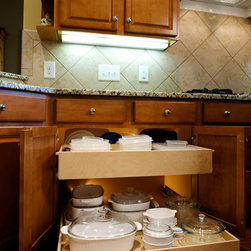 Kitchen Pull Out Shelves - This cabinet has a double-height pull out shelf on top of a single-height pull out shelf.  Choose the right shelf height for your needs.
