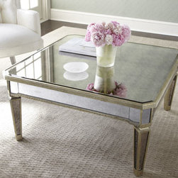 "Horchow - Amelie Mirrored Coffee Table - Reflect on the beauty of this beautiful mirrored coffee table—perfect in any room. Imported. Frame is made of Asian hardwood with silvery finish and golden accents. Covered in antiqued mirrored veneers. 38""W x 38""D x 19""T. Imported. Boxed wei..."