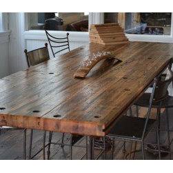 "Reclaimed Pub Height Table - This is a one of a kind table that we have available for sale. There will never be another like it.  The top is made from decommissioned oak railcar flooring and the legs are made from old sawmill wheels from Hollywood South Carolina.  The table is 36"" wide and just under 108"" long.  It is 40"" high"