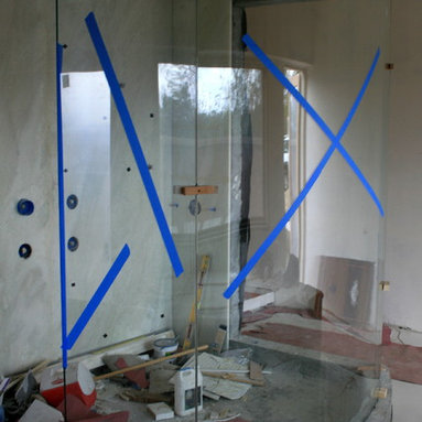 Frameless Shower Enclosures - Installation of a bent tempered glass fabricated in Mexico and shipped to Rancho Santa Fe - A & D Glass Inc.