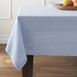 "Seersucker Blue 60""x120"" Tablecloth - Yarn-dyed cotton seersucker tablecloth invokes the breezy summer season all year long, adding texture to your tablescape."