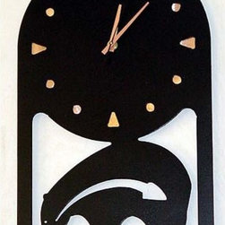 IronCraft - Petroglyph Bear Wall Clock - -Handmade by skilled American craftspeople  -Rust finish  -Slight variations in color and dimensions will occur due to the handmade nature of the product  -During the finishing process each piece of steel develops its own unique pattern of light and dark tones and no two pieces are the same  -Lacquer coated to preserve the beautiful patina  -Clock runs on 1 AA battery, not included    -Made in USA IronCraft - 9855BL01