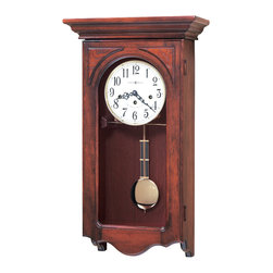 """Howard Miller - Howard Miller - Jennelle Wall Clock - The elegant Janel's 78th Anniversary Cherry Windsor Wall Chimer is 24�_"""" tall and displays a distinctive flat-top pediment accented with olive ash burl corner overlays. The key-wound, Westminster chime movement offers a chime silence option and features durable bronze bushings. * This 78th Anniversary wall clock offers both substance and charm. . The flat top pediment is accented with olive ash burl corner overlays. A sculpted bottom on the hinged door completes the appealing design. . An off-white dial features black Arabic numerals, black serpentine hour and minute hands, and a special 78th Anniversary inscription, inscribed through 2004. . A polished brass finished pendulum and bezel provide the perfect accents to the warm wood case. . Finished in Windsor Cherry on select hardwoods and veneers. . Key-wound, Westminster chime movement with chime silence option and durable bronze bushings. . H. 24-1/4"""" (62 cm) x W. 13"""" (33 cm) x D. 6-1/2"""" (17 cm)"""