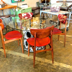 """Dining Table Options - Airplane Engine base with a 48"""" glass round top."""