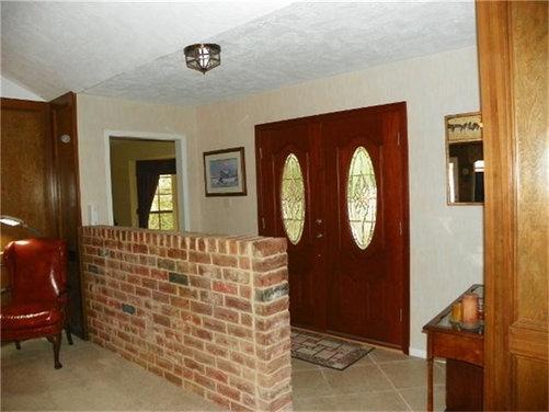 Strange half brick wall in entryway - Houzz