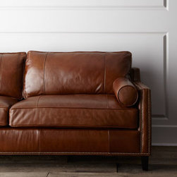 Horchow - Meridian Leather Sofa - This hand-built sofa boasts slick seamed leather in an antique style; perfect for lending a vintage ambiance to contemporary spaces. Upholstered in aniline-dyed top-grain leather with nailhead trim. Blendown feather and foam seat cushions. Springs ar...