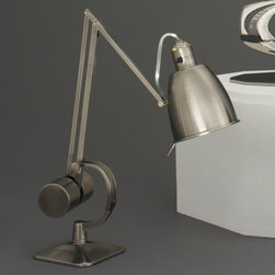 Robert Abbey - Dave Desk Lamp by Robert Abbey - The Robert Abbey Dave Desk Lamp offers a sleek and stylized design complete with hi/low switching. Unique contours matched with an adjustable frame allow for immediate task lighting with contemporary flair. Available in 3 classic finishes that match a number of decorating styles. Robert Abbey has been designing and manufacturing fine lighting since 1946. They offer a diverse collection--wall swingers, chandeliers, floor lamps and more--in myriad styles, from tradition to neoclassical to groovy. Collaborating with acclaimed designers Jonathan Adler, Rico Espinet and David Easton, Robert Abbey creates impeccable lighting that is perfect for modern everyday living.